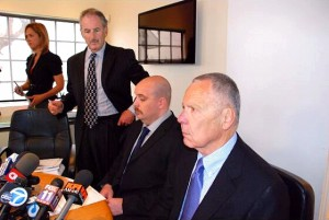 Michael Reeves, center, prepares to read a brief statement flanked by his attorneys, Stephen Allen Jamieson (standing) and Stephen Warren Solomon (right)